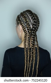 patterns from thin and thick braids creative hairdo in African style, mamasita, close-up on white background