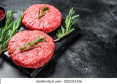 Patty of minced meat for burger. Black background. Top view. Copy space - Shutterstock ID 1832261236