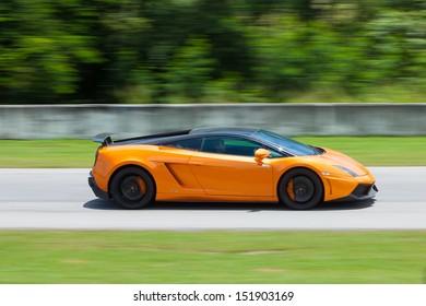 PATTYA, THAILAND-AUG.18 : A driver operated Lamborghini Gallardo Superleggera during the Thailand Super Series 2013 Round 3-4 at Bira International Circuit on August 18, 2013 in Pattaya, Thailand