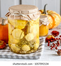 Pattypan squash in glass jar.