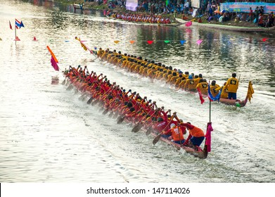 PATUMTHANI, THAILAND - OCT 28: Two rowing teams in full speed during Thai Long-tailed Boat Competition for Royal Championship Cup on October 28, 2012 in Rangsit, Pathumthani, Thailand.