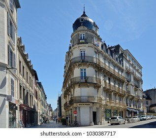 PAU, FRANCE - APRIL 2 2016: The traditional stylish buildings are in the modern street of the ancient city Pau.