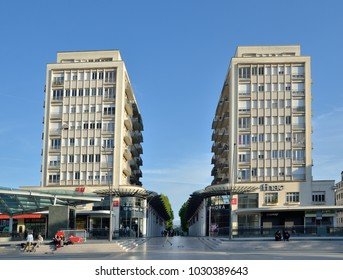 PAU, FRANCE - APRIL 2 2016: A pair of the high buildings stand in the main shopping street in the French city Pau.