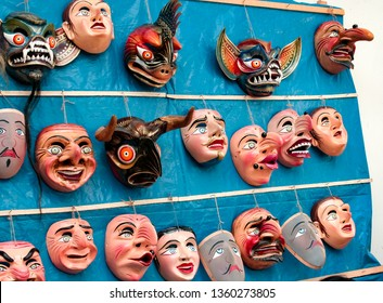 Paucartambo, Cusco, Peru - Circa July 2013: Traditional festival masks hanging on a wall from Paucartambo's religious festival of Virgen del Carmen. Different faces are part of the typical costume.