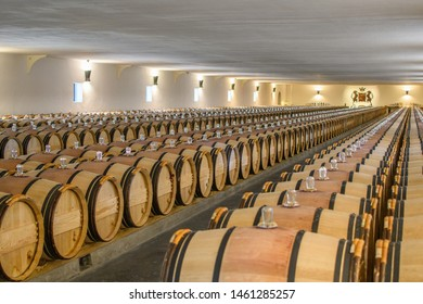 Pauillac, Bordeaux, France - May 05 2019:  Barrels in storage in Château Mouton Rothschild Wine Cellar