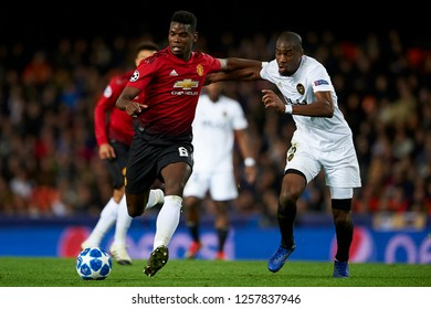 Paul Pogba of Manchester United Geoffrey Kondogbia of Valencia during the match between Valencia CF and Manchester United at Mestalla Stadium in Valencia, Spain on December 12, 2018.