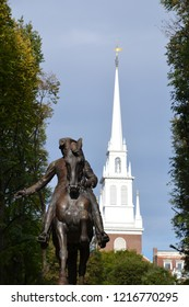 Paul Revere statue with the Old North Church steeple behind