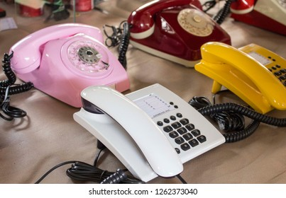 São Paulo / São Paulo / Brazil - 08 19 2018: Group of four or five vintage telephones colored with multiple and different styles at a flea market