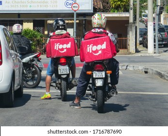 São Paulo, Brazil, April 28, 2020. Two motorcyclists, employees of Ifood, deliver food to customers in the city. Increased demand during the Covid-19 pandemic.