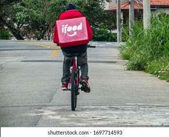 Taubaté, São Paulo, Brazil, April 7, 2020 - Ifood's bicycle worker delivers food to city customers during the Covid-19 coronavirus crisis. Ifood