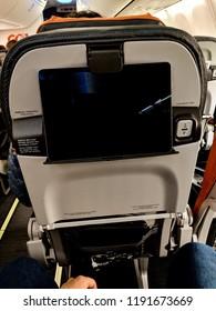 São Paulo, Brazil - August 12, 2018: Seat back tablet holder on Gol 737 flight from São Paulo to Manaus, Brazil.
