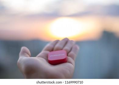 São Paulo, São Paulo / Brazil - Circa September 2018: Hand of a man holding the company logo Shutterstock.