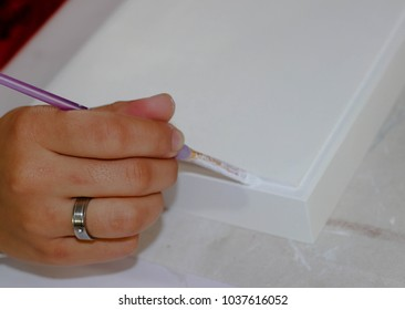 São Paulo/ São Paulo/ Brazil- February 20 2018: Close up of the hand of the girl doing a painting job on the whiteboard