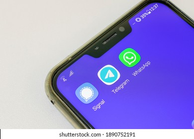 São Paulo, Brazil - January 10, 2021: cell phone with Signal, Telegram and WhatsApp applications, all for sending messages, files, voice and videos.