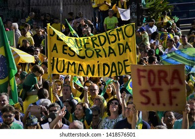 "São Paulo, Brazil, May, 26,2019: Demonstrators holding the written track: ""Left the slag of humanity"" at the pro-reform demonstration of the Bolsonaro government on Paulista Avenue"