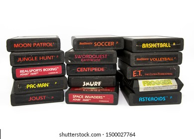São Paulo, Brazil- September 9, 2019:  A studio shot of a lot of game cartridges of Atari 2600  system isolated on a white background.