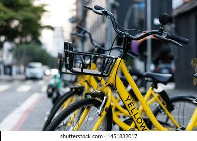 São Paulo, SP  Brazil - 15/07/2019 - Yellow share bikes on the street of São Paulo