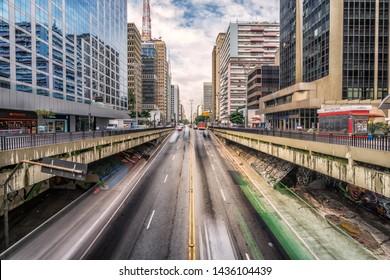 São Paulo/Brazil - June 1st 2019: Long Exposure Traffic Light Trails During the Day in Paulista Avenue (Avenida Paulista), Famous Landmark in Modern Downtown São Paulo