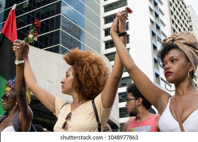SÃO PAULO/SÃO PAULO/BRAZIL - MARCH 18, 2018: Hundreds of people protest against the murder of Marielle Franco, a Rio de Janeiro councillor who was shot dead on the previous Wednesday night.