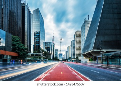 São Paulo/SP/Brazil - June 01st 2019: Paulista Avenue Modern Buildings, Long Exposure of Traffic Light Trails and Bicycle Path with FIESP Cultural Center and its Distinct Architecture on the Right
