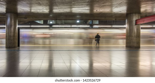 São Paulo/SP/Brazil - May 31th 2019: Motion Blur of Subway Cars and People at Peak Hour in Sé Subway Station Hub (Estação da Sé) that connects lines Red and Blue