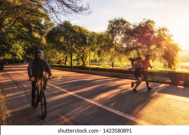 São Paulo/SP/Brazil - May 31th 2019: People Running in Ibirapuera Urban Park with Beautiful Morning Light. The Park is a listed Historical Patrimony of the City of São Paulo