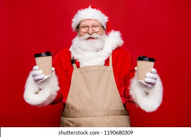 Pause break concept. Rejoice emotions cheerful stylish positive handsome glad aged grandfather Santa in gloves white beard hold two hot beverages takeout isolated on noel red background