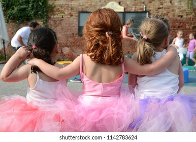 Pavarolo – Piedmont /Italy  - June 7, 2014: little dancers who hug each other dressed in beautiful pink tutus because sport helps friendship and brotherhood.