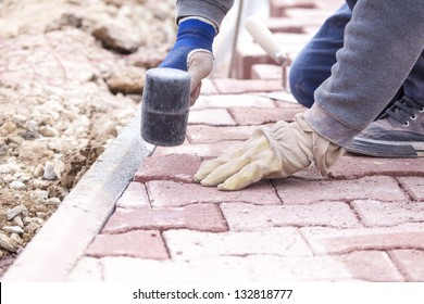 Pave bricks setting by rubber hammer