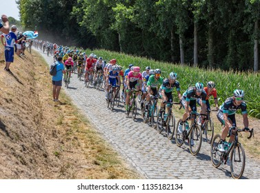 Pave Escaudoeuvres a Thun, France - July 15 , 2018: Peter Sagan of Bora-Hansgrohe Team in Green Jersey rides in the peloton on a cobblestone road during the stage 9 of Le Tour de FRance 2018