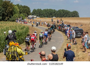 Pave Escaudoeuvres a Thun, France - July 15 , 2018: The breakaway riding on a cobblestone road during the stage 9 of Le Tour de FRance 2018
