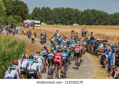 Pave Escaudoeuvres a Thun, France - July 15 , 2018: Rear view of the peloton riding on a cobblestone road during the stage 9 of Le Tour de FRance 2018