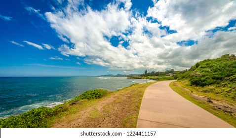 A paved bike path/walkway along the coast in Kauai, Hawaii, USA