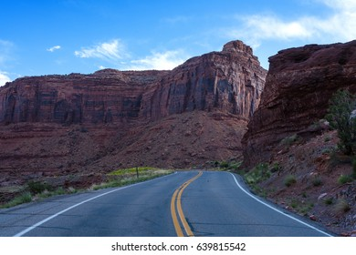 Paved highway with no traffic in canyon and Mesa country of Southern Utah
