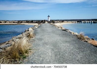 Paved jetty walkway to the Edgartown Lighthouse on Martha's Vineyard Massachusetts
