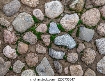 Paved road background. Paved surface top view. Paved area view. Paved stones background