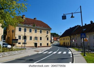 Paved road leading through the town of Zuzemberk in Suha Krajina, Dolenjska, Slovenia - Shutterstock ID 2045773556