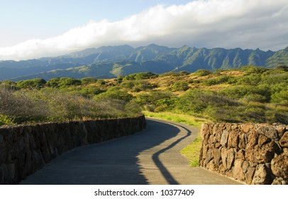 Paved road leads to Koolau Mountains in Oahu