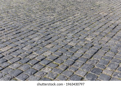 Paved street with basalt paving stones.