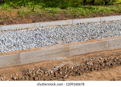 pavement construction site, beton blocks and gravel