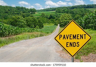 Pavement Ends Sign:  Motorists are warned of a change from asphalt to gravel on a country road in northern Maryland.
