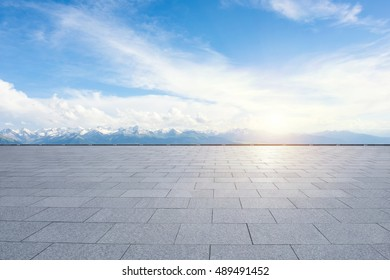 pavement in front of mountains
