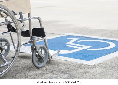 Pavement handicap symbol and wheelchair