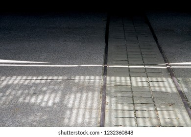 A pavement leading to an unknown dark area. The abstract concept of uncertainty, dangerous, adventure.