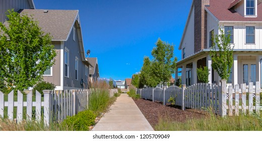 Pavement outside homes in sunny Daybreak Utah