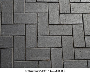 Pavement surface, stone pavement texture. Granite cobblestoned pavement background.
