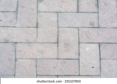Pavement tiles in light red pink colors.