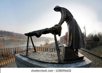 Pavia, Italy -02-10-2019: The washerwoman of the old village