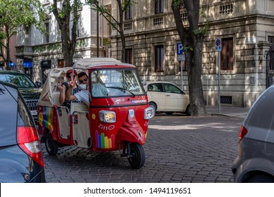 Pavia, Italy 08.22.2019 Tuc-Tuc transport in Pavia, a red small three whiels car provide trasportation service like a taxi or cab.