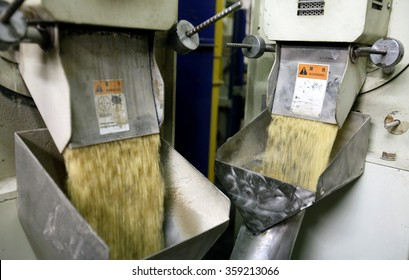 PAVIA, ITALY - 16 APRIL 2012: A view of grains of cleaned parboiled rice inside a rice processing and packaging plant in Pavia, Italy.